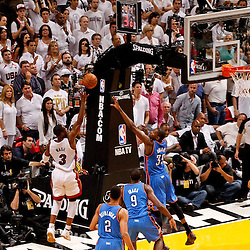 Jun 19, 2012; Miami, FL, USA; Miami Heat shooting guard Dwyane Wade (3) shoots over Oklahoma City Thunder small forward Kevin Durant (35) during the fourth quarter in game four in the 2012 NBA Finals at the American Airlines Arena. Miami won 104-98. Mandatory Credit: Derick E. Hingle-US PRESSWIRE