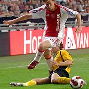 NLD/Amsterdam/20060928 - Voetbal, Uefa Cup voorronde 2006, Ajax - IK Start, Tom de Mul in duel met David Hanssen