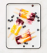Gourmet orange dreamsicles melting with blueberries