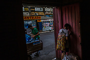 A boy takes a rest from his snack selling job at a street market in Asuncion, Paraguay, Monday, Dec. 18, 2017. Paraguay today is trying to promote a positive image of Guaraní. But centuries of subjugation have rendered it a second class language in the minds of many Paraguayans.(Dado Galdieri for The New York Times)
