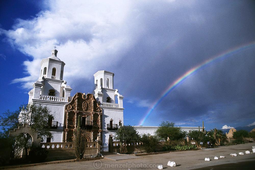Mission San Xavier del Bac with rainbow. Tucson, Arizona, USA.