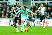 Kenedy (#15) of Newcastle United and Lewis Cook (#16) of Bournemouth battle for possession of the ball during the Premier League match between Newcastle United and Bournemouth at St. James's Park, Newcastle, England on 10 November 2018.