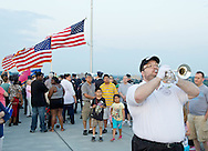 Highland, New York - A bugler plays taps during a Memorial Day ceremony at the center of the Walkway over the Hudson on May 27, 2012.