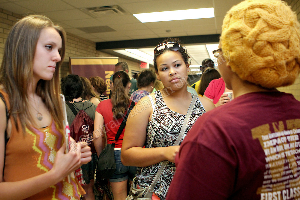 A staff member speaks with students about different programs during the College of Humanities and Social and Behavioral Sciences college day photo by Emily Mesner