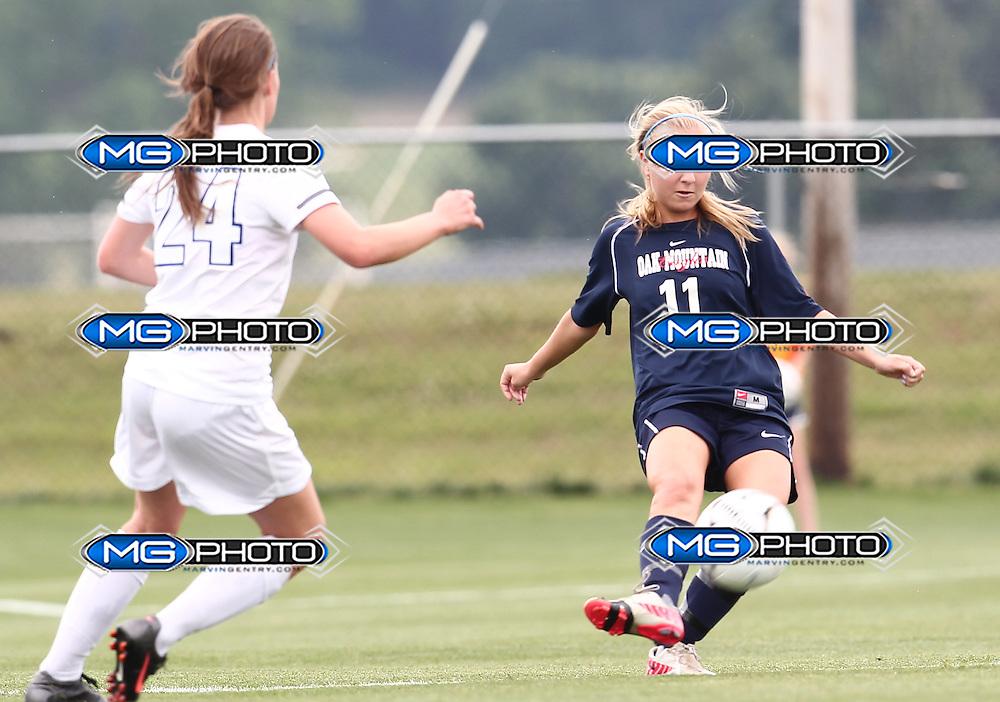 May 12, 2012; Huntsville, AL, USA; Oak Mountain's Cameron Morris (11) kicks the ball away from Auburn's Katelyn Patrick (24) Mandatory Credit: Marvin Gentry