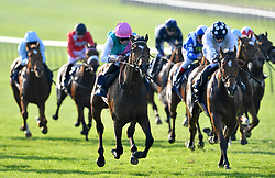 Breath Caught ridden by Ryan Moore (centre) goes on to win The Close Brothers Premium Finance Handicap during day three of The Bet365 Craven Meeting at Newmarket Racecourse.