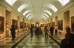 Prado Museum; Madrid; with visitors looking at paintings,