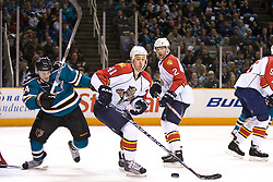 March 13, 2010; San Jose, CA, USA; Florida Panthers center Shawn Matthias (41) shields the puck from San Jose Sharks left wing Jamie McGinn (64) during the first period at HP Pavilion. Florida defeated San Jose 3-2 in overtime. Mandatory Credit: Jason O. Watson / US PRESSWIRE
