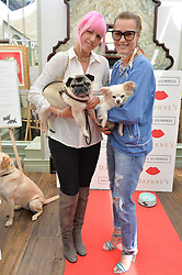 Left to right, AMBER BE BON and YASMIN LE BON and their dogs Luigi & Tinka at a party hosted by Lulu Guinness and Daphne's to launch Lulu's Designer Dog Bowl and to mark Daphne's allowing dogs through it's doors, held at Daphne's, Draycott Avenue, London on 28th June 2016.