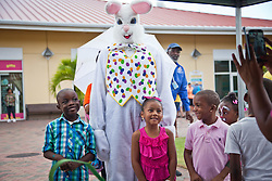 (L-R) Gah'Ny Reed, Anjolie Alvalle, and Tyler Clark pose with the Easter Bunny for a picture.  The Easter Bunny visits with children.  Easter Sunday Extravaganza at Crown Bay Center.  St. Thomas, VI.  5 April 2015.  © Aisha-Zakiya Boyd
