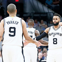 04 April 2017: San Antonio Spurs guard Patty Mills (8) congratulates San Antonio Spurs guard Tony Parker (9) during the San Antonio Spurs 95-89 OT victory over the Memphis Grizzlies, at the AT&T Center, San Antonio, Texas, USA.