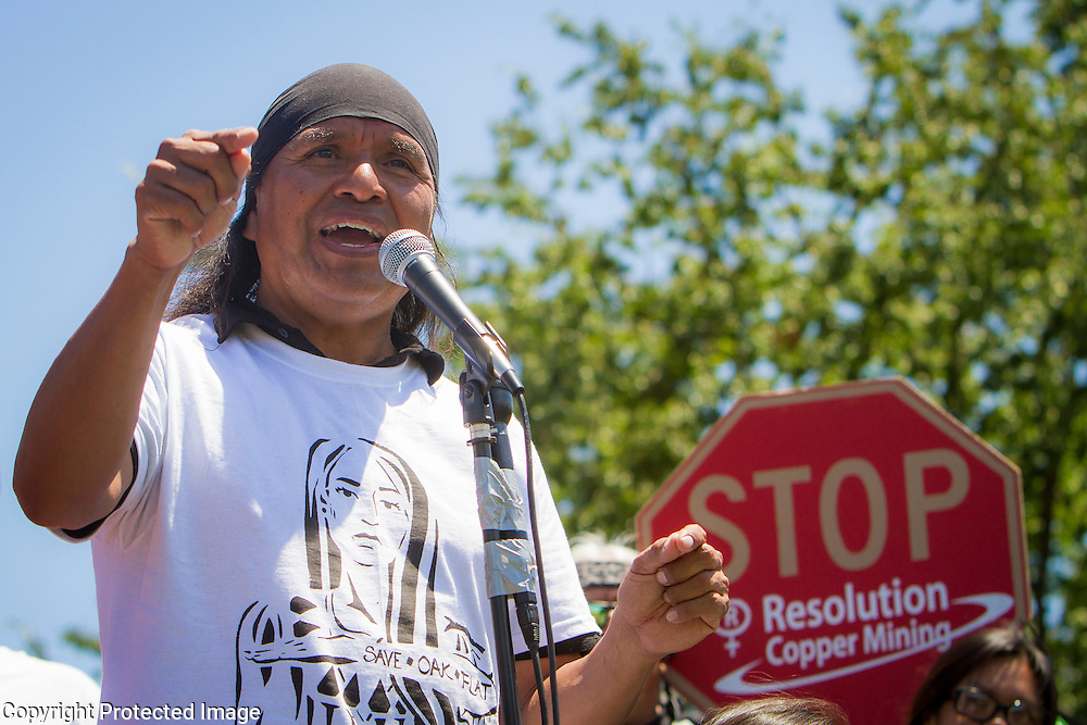 "Wendsler Nosie, Sr, tribal councilman, speaks to fellow members of the San Carlos Apache Tribe and their supporters in front of the United States Capitol to protest the transfer of Apache land to a private Australian-British mining corporation.  In December 2014, a rider to the National Defense Authorization Act handed over Oak Flat to a foreign-owned company looking to mine copper.  The Apache are currently ""occupying"" Oak Flat, and travelled to D.C. to protest the action.  In response, Rep. Raul Grijalva (D-AZ-3), proposed the Save Oak Flat Act (H.R. 2811) in June, 2015 to repeal the land exchange.  John Boal Photography"