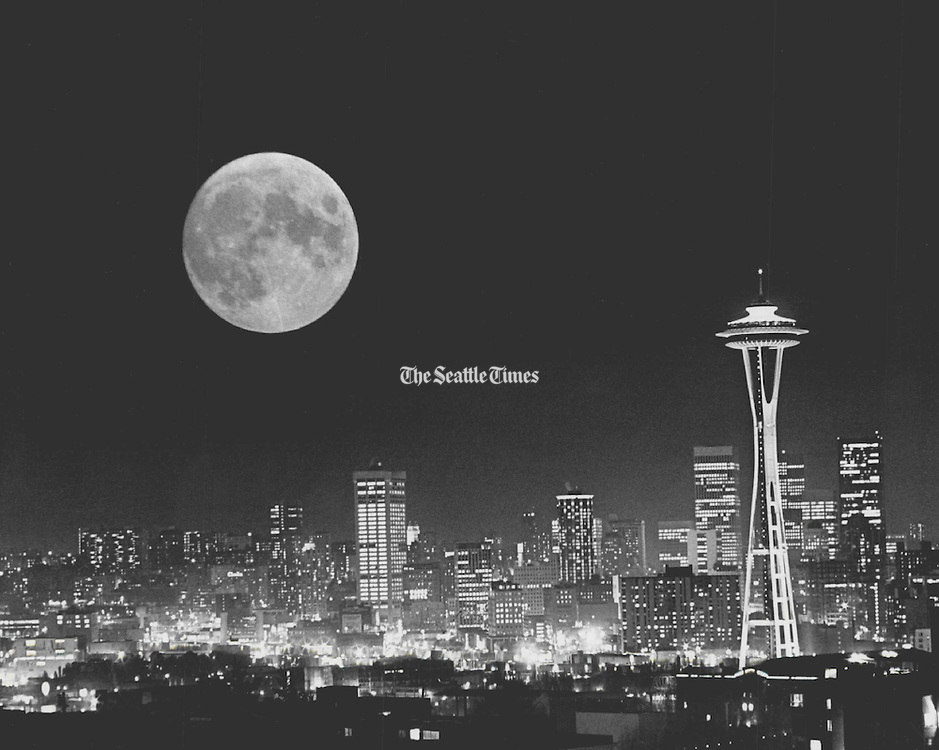 Cold, clear weather, abetted by a double exposure, put the moon in line with the downtown area in this view from Queen Anne Hill. The moon, unusually clear because of the cold, and the cityscape were photographed separately with telephoto lenses. (Greg Gilbert / The Seattle Times, 1979)