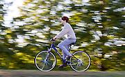 "Robert Radloff rides his bike on the Athens County bike path. ""It's just really pretty right now,"" said Radloff"