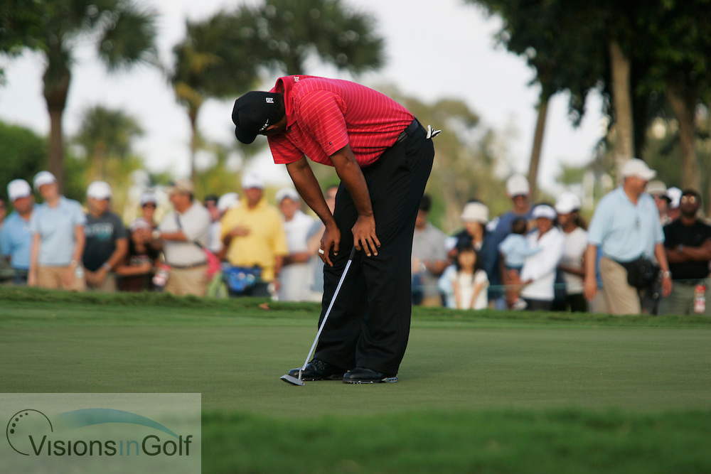 Tiger Woods on the final day reacts and looks down and away frustrated as he misses a putt on the 17th hole<br /> WGC CA Championship, Doral, Blue monster GC, Florida USA. March 2007. <br /> Picture Credit:   Mark Newcombe / visionsingolf.com