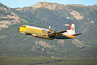 Airspray Lockheed Electra water bomber taking off from Whitehorse International Airport (CYXY)
