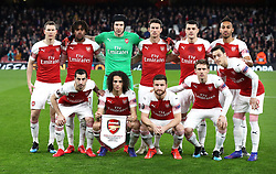 Arsenal players (left to right, top to bottom) Stephan Lichtsteiner, Alex Iwobi, goalkeeper Petr Cech, Laurent Koscielny, Granit Xhaka, Pierre-Emerick Aubameyangduring, Henrikh Mkhitaryan, Matteo Guendouzi, Shkodran Mustafi, Nacho Monreal, and Mesut Ozil prior to kick-off during the UEFA Europa League round of 32 second leg match at the Emirates Stadium, London.