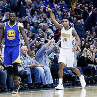 13 February 2017: Denver Nuggets guard Gary Harris (14) celebrates next to Golden State Warriors forward Draymond Green (23) during the Denver Nuggets 132-110 victory over the Golden State Warriors, at the Pepsi Center, Denver, Colorado, USA.