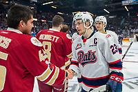 REGINA, SK - MAY 27:  Sam Steel #23 of Regina Pats shakes hands with the Acadie-Bathurst Titan at Brandt Centre - Evraz Place on May 27, 2018 in Regina, Canada. (Photo by Marissa Baecker/CHL Images)