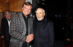 Left to right, actor JESS CONRAD and DENNIS HOPPER at an exhibition of photographs by Jack Cardiff held at The Royal College of Art, Kensington Gore, London on 10th November 2004.<br />