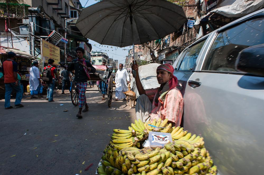 Man selling bananas in Kolkata (India).
