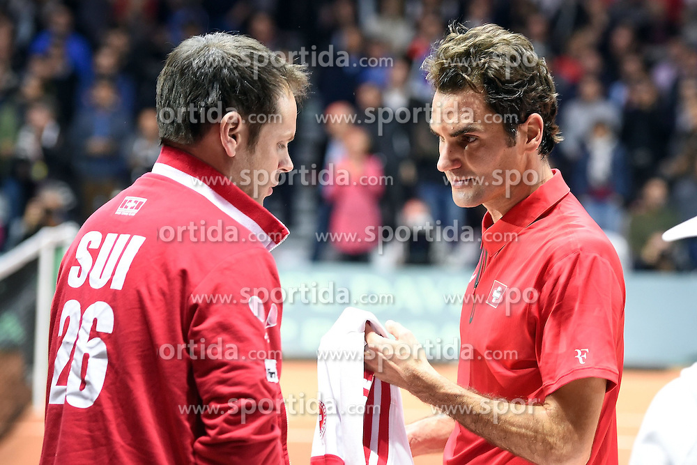 21.11.2014, Stade Pierre Mauroy, Lille, FRA, Davis Cup Finale, Frankreich vs Schweiz, im Bild Severin Luethi und Roger Fderer (SUI) // during the Davis Cup Final between France and Switzerland at the Stade Pierre Mauroy in Lille, France on 2014/11/21. EXPA Pictures &copy; 2014, PhotoCredit: EXPA/ Freshfocus/ Daniela Frutiger<br /> <br /> *****ATTENTION - for AUT, SLO, CRO, SRB, BIH, MAZ only*****