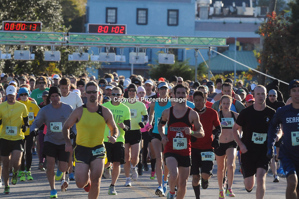 Runners start the 16th Annual Battleship Half Marathon. (Jason A. Frizzelle)