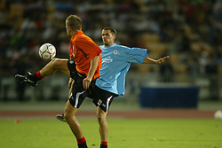 BANGKOK, THAILAND - Wednesday, July 23, 2003: Liverpool's Michael Owen and Igor Biscan during a training session in at the Rajamangala National Stadium. (Pic by David Rawcliffe/Propaganda)