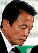 Taro Aso, president of Japan's ruling Liberal Democratic Party and prime minister of Japan, looks dejected as general election results are recorded on a board at the LDP's headquarters in Tokyo, Japan on Sunday 30 August 2009..