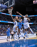 Chastity Melvin and Marissa Coleman of the Washington Mystics defend against Armintie Price of the Atlanta Dream, September 12, 2009.