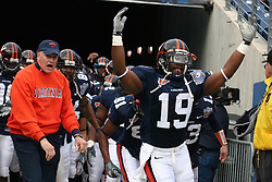 Virginia wide receiver Emmanuel Byers (19) and head coach Al Groh lead UVA out of the tunnel.  The Virginia Cavaliers defeated the Minnesota Golden Gophers 34-31 at the Music City Bowl in Nashville, TN on December 30, 2005.