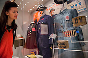 Air raid warden outfits - Fashion on the Ration: 1940s Street Style – a new exhibition at the Imperial War Museum to mark the 70th anniversary of the end of the Second World War in 1945.  Divided into six sections:  Into Uniform looks at how Second World War Britain became a nation in uniform;  Functional Fashion explores how the demands of wartime life changed the way civilians dressed at work and at home;  Rationing and Make do and Mend will look at why clothes rationing was introduced in 1941, how the scheme worked and how it changed the shopping habits of the nation, including a bridesmaid's dress made from parachute material, a bracelet made from aircraft components, a child's coat made from a blanket and on display for the first time a bra and knickers set made from RAF silk maps for Countess Mountbatten;  Utility Clothing was introduced in 1941 to tackle unfairness in the rationing scheme and standardise production to help the war effort; Beauty as Duty examines the lengths to which many women went, to maintain their personal appearance – and the pressure they felt to do so; and Peace and a new look? which looks at how the end of the war impacted upon fashion, and considers the long-term impact, including a 'VE' print dress worn by the comedienne Jenny Hayes to celebrate the end of the war, and an example of the ubiquitous demob-suit, issued to men leaving the military services. The exhibition runs from 5 March – 31 August 2015