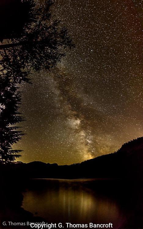 The Milky Way reflected across Lake Dorothy.