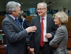 Didier Reynders, Belgium's finance minister, left, speaks with Olli Rehn, The EU's economic and monetary affairs commissioner, center, and Elena Salgado, Spain's finance minister, during the emergency meeting of European Union finance ministers in Brussels, Belgium, on Sunday, May 9, 2010.  European Union finance ministers meet today to hammer out the details of an emergency fund to prevent a sovereign debt crisis from shattering confidence in the 11-year-old euro. (Photo © Jock Fistick)