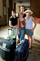 2nd Sept, 2005. New Orleans, Louisiana.<br /> British tourists trapped at the Hyatt in New Orleans prepare to evacuate. The Watson family. L/R Kirstie, Les, Karly (12yrs) and Trish. <br /> Photo Credit; Charlie Varley/varleypix.com