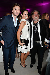 Left to right, BEN CARING, ELLE CARING and ROBERT TCHENGUIZ  at a party to launch the Autumn/Winter 2013 Candy Magazine held at The Saatchi Gallery, Duke of York's HQ, King's Road, London on 15th October 2013.