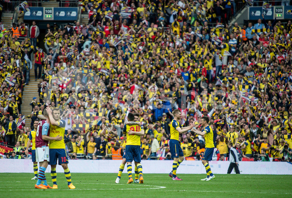 The final whistle goes and the Arsenal players celebrate during the The FA Cup Final match between Arsenal and Aston Villa at Wembley Stadium, London, England on 30 May 2015. Photo by Liam McAvoy.