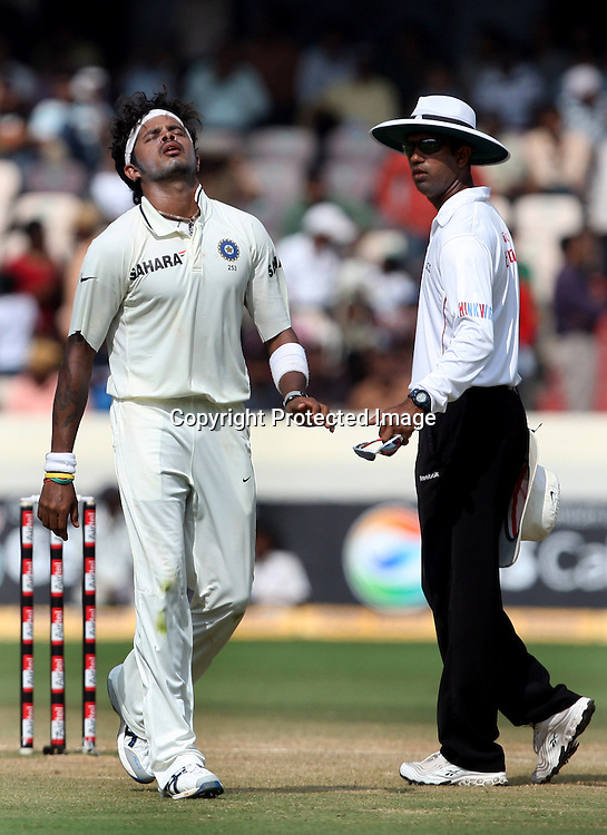 ICC Umpire Kumar Dharmasena and Indian bowler S. Sreesanth during the Indian vs New Zealand 2nd test match day-5 Played at Rajiv Gandhi International Stadium, Uppal, Hyderabad 16 November 2010 (5-day match)
