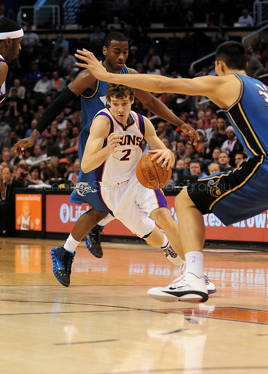 Dec. 5 2010; Phoenix, AZ, USA; Phoenix Suns guard Goran Dragic (2) handles the ball  during the second half against Washington Wizards forward Yi Jianlian (31) at the US Airways Center. The Suns defeated the Wizards 125-108. Mandatory Credit: Jennifer Stewart-US PRESSWIRE.