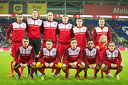 CARDIFF, WALES - Friday, October 11, 2013: Wales' players line up for a team group photograph before the 2014 FIFA World Cup Brazil Qualifying Group A match against Macedonia at the Cardiff City Stadium. Back row L-R: Hal Robson-Kanu, goalkeeper Wayne Hennessey, James Collins, Simon Church, Declan John Craig Bellamy. Front row L-R: Aaron Ramsey, Chris Gunter, Andy King, Neil Taylor, David Vaughan. (Pic by David Rawcliffe/Propaganda)
