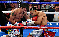 LAS VEGAS, NEVADA - JULY 20. <br /> Manny Pacquiao (L) hits Keith Thurman in during their WBA welterweight title fight at MGM Grand Garden Arena on July 20, 2019 in Las Vegas, Nevada. Pacquiao went 12 rounds and took the win by a split decision.  (MB Media)