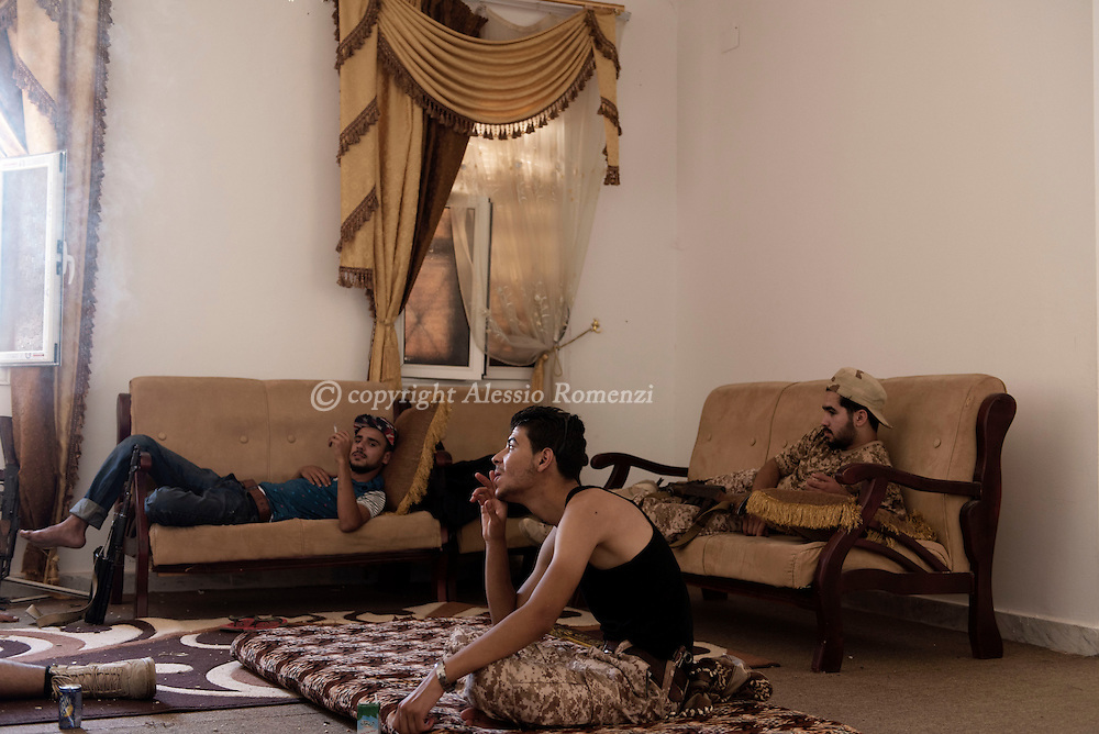 Libya: Libya's Government of National Accord's (GNA) fighters take some rest inside a house on the frontline with ISIS in Sirte. Alessio Romenzi