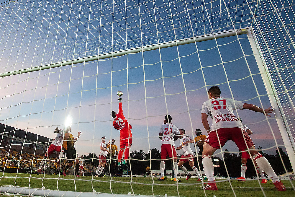 New York's Evan Louro (24) punches the ball away. <br /> New York RedBulls II vs. Charleston Battery at MUSC Health Stadium in Charleston, S.C. on Saturday, , 2017.<br /> Zach Bland Photo