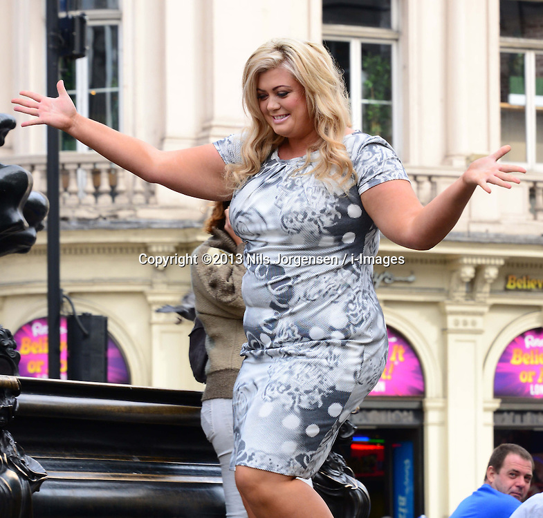 Gemma Collins - PETA<br /> TOWIE star unveils her new ad for animal rights charity PETA in which she's pictured wearing 'nothing but a smile and faux pearls', shot by celebrity photographer Karl Grant, Piccadilly Circus, London, United Kingdom. Tuesday, 10th September 2013. Picture by Nils Jorgensen / i-Images