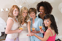 Bride standing together with friends showing engagement ring