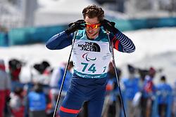 DAVIET Benjamin FRA LW2 competing in the ParaBiathlon, Para Biathlon at  the PyeongChang2018 Winter Paralympic Games, South Korea.