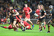 Wasps fly half Jacob Umaga (10) gets a pass away as he is tackled during the Gallagher Premiership Rugby match between Wasps and Saracens at the Ricoh Arena, Coventry, England on 21 February 2020.