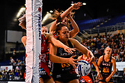 Abigail Latu-Meafou of the Magic gets a ball from Jane Watson of the Tactix and Sophia Fenwick of the Tactix during the ANZ Premiership Netball match, Tactix v Magic, Horncastle Arena, Christchurch, New Zealand, 19th May 2019.Copyright photo: John Davidson / www.photosport.nz