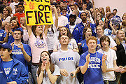 """Ellie Hill proudly displays a """"We're on FIRE"""" sign as Madison's Region B Final game draws to a close.  Madison has burned through their District and Regional playoff games outscoring their opponents by a combined  154 points as they head into the State Tournament.  Date:  February/27/10, Group A, Region B Final Basketball game at Spotswood High School, Madison Mountaineers defeat Altavista Colonels 59-31 to win the Region B Championship.  Jerel Carter led Madison with 15 points, followed by Logan Terrell with 11, David Falk with 10, Patrick Lucas 6, Matt Garr 5, Trey Hensley 5, Rashad Bolden 3, Casey Campbell 2, and Dominic Roebuck 2."""