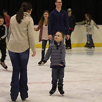 Hayden Bradford, 4, practices skating by himself Saturday, with his mom Mary, left, close by at the Bancorpsouth Arena